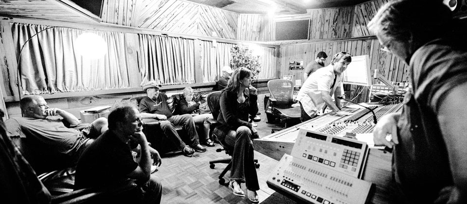 Mary James and crew listening to playback.